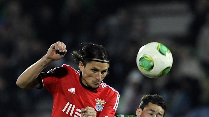 Benfica's Nemanja Matic, left, from Serbia vies for the ball against Rio Ave's Diego Lopes, from Brazil, in a Portuguese League soccer match, in Vila do Conde, Portugal, Sunday, Dec. 1, 2013