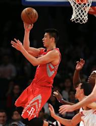 Jeremy Lin of the Houston Rockets passes the ball in the second half against the New York Knicks on December 17, 2012 at Madison Square Garden. The Houston Rockets defeated the New York Knicks 109-96. The sellout crowd at the Garden gave Lin a loud ovation during the pre-game introductions