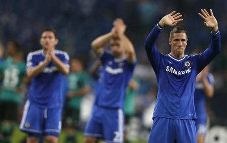 Chelsea's Fernando Torres waves at the end of their Champions League soccer match against Schalke 04 in Gelsenkirchen October 22, 2013. REUTERS/Wolfgang Rattay