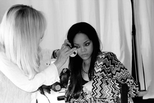 Celebrity photos: Rihanna has shared some intimate backstage photos with her Facebook fans. This one shows the singer having her makeup applied, in an unusually candid shot.