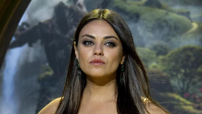 """In this Feb. 28, 2013 photo, Actress Mila Kunis arrives at the European premiere of Oz: The Great And Powerful in London.   Kunis' stardom and general idolization went up a notch last week, and you would think this is because she stars in the biggest movie of the year so far. But """"Oz the Great and Powerful,"""" which debuted with $79.1 million at the box office, had hardly anything to do with the sudden rush of adulation that engulfed Kunis. Instead, it was a seven-minute viral video that's been watched more than 10 million times and blogged about the world over.(Photo by Joel Ryan/Invision/AP)"""