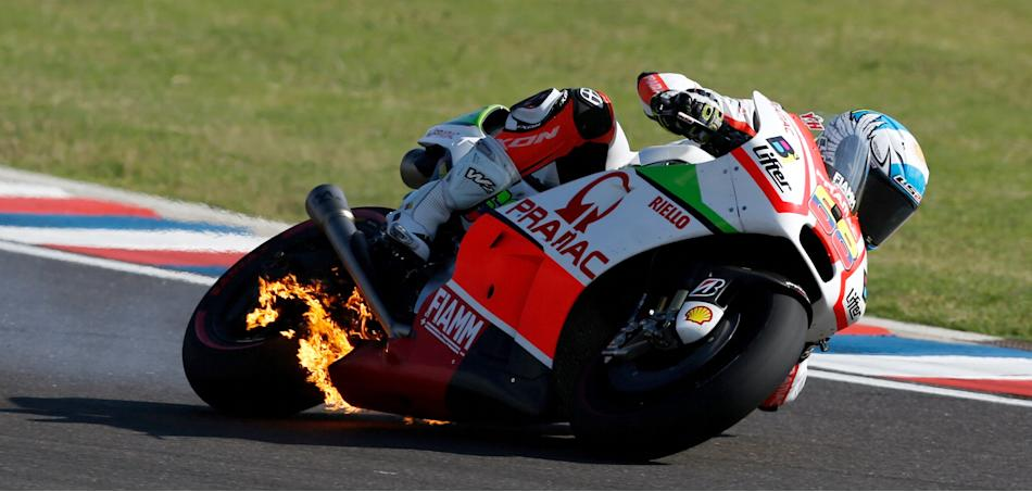 Hernandez of Colombia rides his motorcycle as fire is seen on it during Argentina's MotoGP Grand Prix in Termas de Rio Hondo