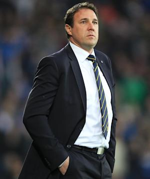 Malky Mackay aims to keep his Cardiff players grounded after taking over as Championship leaders