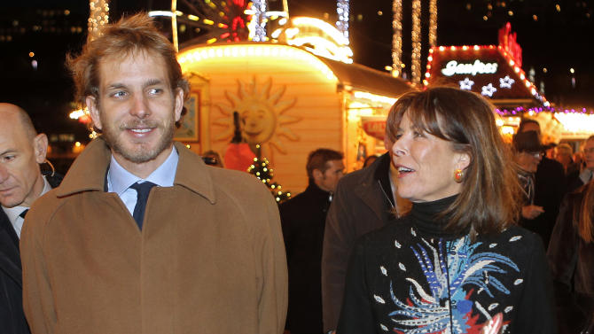 FILE -  Princess Caroline of Hanover, right, and her eldest son Andrea Casiraghi,  attend the opening of the Christmas village in Monaco, in this file photo dated Wednesday, Dec. 5, 2012.  A baby boy is the latest addition to this jet set royal family, it is announced Friday March 22, 2013, born to Andrea Casiraghi and his Colombian fiancee heiress Tatiana Santo Domingo. Mother and child are understood to be in good health. (AP Photo/Lionel Cironneau, file)