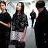 Models wait backstage prior to the Devastee's fall-winter 2015-2016 ready to wear fashion collection presented in Paris, France, Tuesday, March 3, 2015. (AP Photo/Thibault Camus)