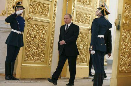 Putin attends a ceremony in Moscow
