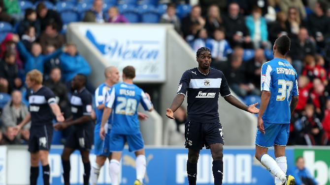 Anthony Grant, centre right, cannot believe the decision to show him a red card