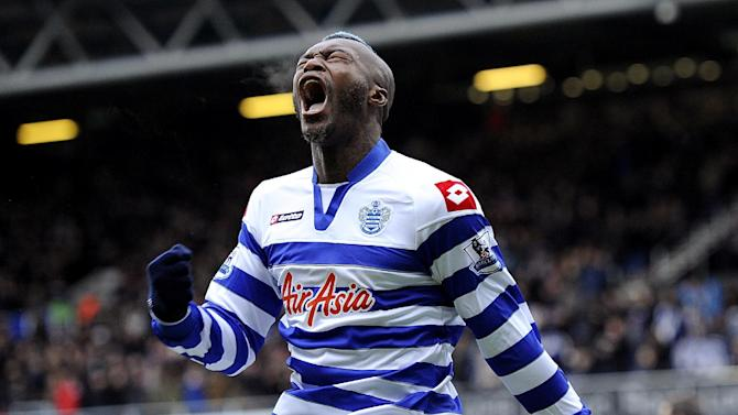 QPR's Djibril Cisse celebrates scoring his side's equaliser against Reading