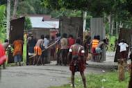 Papuan tribal warriors armed with bows and arrows and improvised shields from Amole village (foreground) clash with tribes from Harapan village (background) during renewed fighting between the two tribes in Mimika district, located in Indonesia's restive Papua province. One more tribesman was killed, raising casualty figure in the raging tribal war to four dead