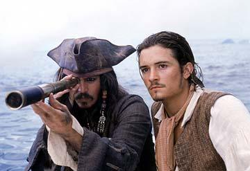 Johnny Depp and Orlando Bloom of Walt Disney's Pirates Of The Caribbean: The Curse of the Black Pearl