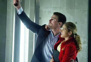 Stephen Amell and Emily Bett Rickards | Photo Credits: Cate Cameron/The CW.