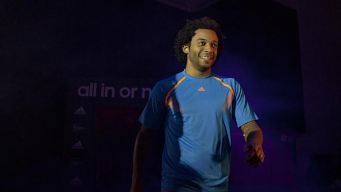 Real Madrid's Marcelo of Brazil takes part in a soccer boot promotional event in Madrid, Spain. Thursday Nov. 21, 2013