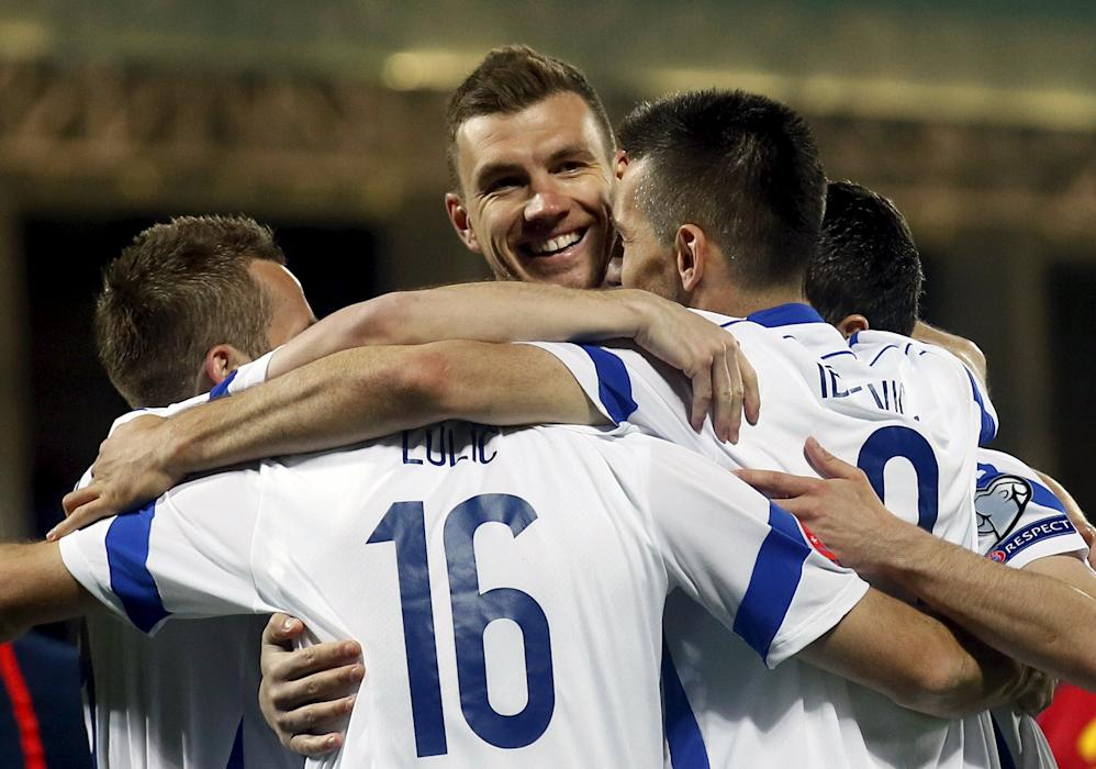 Bosnia and Herzegovina's Edin Dzeko  celebrates a goal with his team mates against Andorra during their Euro 2016 qualifier match in Andorra La...