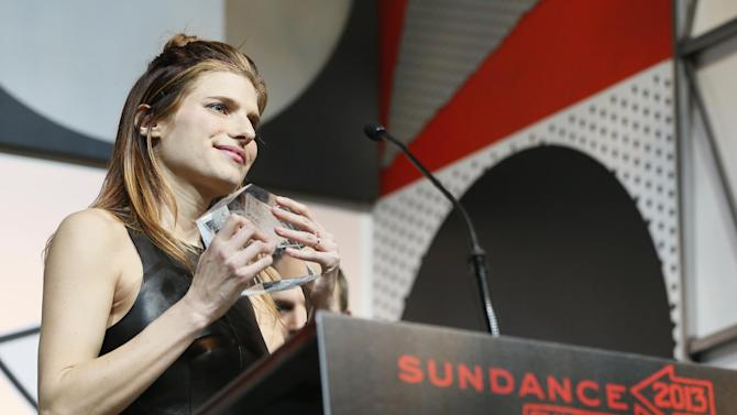 """Director, writer and cast member Lake Bell accepts her U.S. Dramatic Waldo Salt Screenwriting Award for """"In A World..."""" during the 2013 Sundance Film Festival Awards Ceremony on Saturday, Jan. 26, 2013 in Park City, Utah. (Photo by Danny Moloshok/Invision/AP)"""