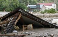 A chair lies under a destroyed house in Jamestown, Colorado, after a flash flood destroyed much of the town, September 14, 2013. REUTERS/Rick Wilking