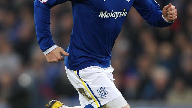 Football - Gunnarsson stretches Cardiff lead at top