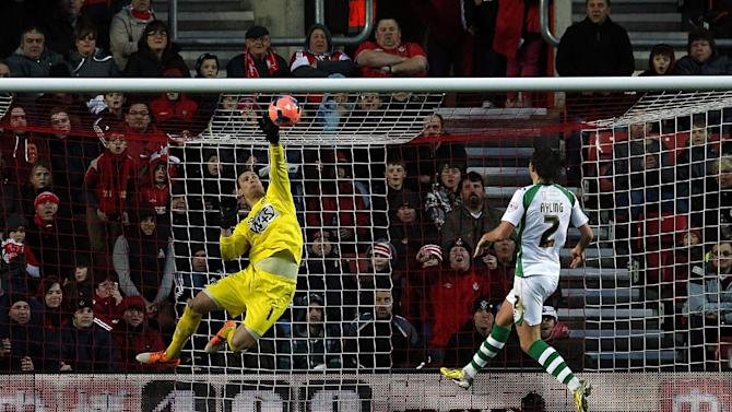 Yeovil Town's goalkeeper Marek Stech, left, makes a save at full stretch during the FA Cup fourth round soccer match between Yeovil Town and Southamption at St Mary's, Southampton, England, Saturday, Jan. 25, 2014