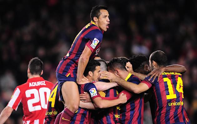 FC Barcelona players celebrate Lionel Messi's goal during a Spanish La Liga soccer match against Athletic Bilbao at the Camp Nou stadium in Barcelona, Spain, Sunday April 20, 2014. (AP Photo/Manu