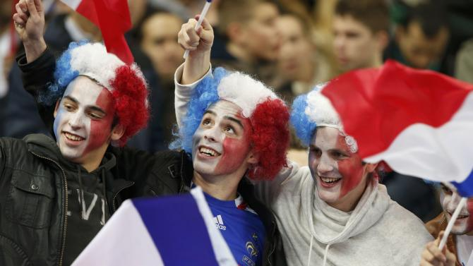 France's fans attend the international friendly soccer match between France and the Netherlands at the Stade de France in Saint-Denis