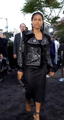Jada Pinkett Smith keeps a good five steps ahead of the law, or at least ahead of the guy with the cop mustache, at the Hollywood premiere of Warner Brothers' The Matrix: Reloaded