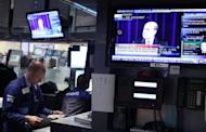 Fed Chairman Ben Bernanke is seen on screens on the floor of the New York Stock Exchange as he speaks at a news conference on September 13, in New York City. The US Federal Reserve took aim at slow growth and high joblessness, announcing a new, open-ended $40 billion per month bond-buying program as it slashed its 2012 growth forecast