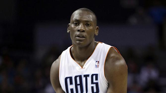 Charlotte Bobcats' Bismack Biyombo reacts after being called for a delay of game during the second half of an NBA basketball game against the Indiana Pacers in Charlotte, N.C., Wednesday, Nov. 27, 2013. The Pacers won 99-74
