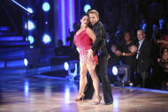"""In this Nov. 21, 2011 photo released by ABC, Ricki Lake and her partner Derek Hough perform on the celebrity dance competition series """"Dancing with the Stars,"""" in Los Angeles. On Tuesday, the remaining three couples will perform their favorite dance of the season for another score from the judges before the third-place finalists are eliminated. The remaining two pairs will compete in one final routine for the season 13 title. (AP Photo/ABC, Adam Taylor)"""