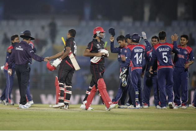 Nepal cricketers, right, celebrate after they defeated Hong Kong by 80 runs during their ICC Twenty20 Cricket World Cup match in Chittagong, Bangladesh, Sunday, March 16, 2014. (AP Photo/Bikas Das)