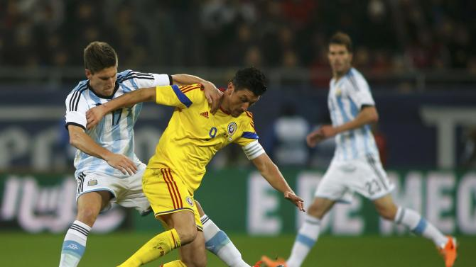 Romania's Marica challenges Argentina's Fernandez during their international friendly soccer match at the National Arena in Bucharest