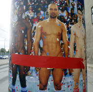 """TO GO WITH STORY BY GEORGE JAHN - AUSTRIA NAKED MEN - In this picture taken Oct. 18, 2012 a poster with naked men is on display in Vienna, Austria, Thursday, Oct. 18, 2012 Poster reads: Naked Men. It's raining men - naked men of all sizes and shapes- as a prestigious Vienna museum kicks off a show of male nudity. But outside the exhibition, organizers are being forced into cover-up mode after a storm of complaints that posters splashed across the city advertising the art are offensive. Entitled """"Naked Men from 1800 to Today,"""" the Leopold Museum opened its doors Friday Oct 19, 2012 to a display showing how artists dealt with the theme of male nudity over more than two centuries. (AP Photo/Ronald Zak)"""