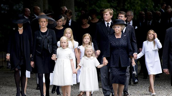 Members of the Dutch royal family, from left: Queen Maxima, Princess Mabel, Princess Luana, Princess Amalia, Princess Alexia, Princess Zaria, King Willem-Alexander and Princess Beatrix arrive at the church for a private funeral for Prince Friso in Lage Vuursche, central Netherlands, Friday, Aug. 16, 2013. Friso, the younger brother of King Willem-Alexander, died this week due to complications from a 2012 skiing accident. He died on Monday, aged 44. Friso is survived by his wife, Princess Mabel, and two young daughters. (AP Photo/Koen van Weel, HO)