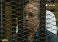 An image grab taken from Egyptian state TV shows former interior minister Habib al-Adly behind bars at a courthouse in Cairo. Egypt's former president Hosni Mubarak and his security chief were given life in prison over the deaths of protesters in 2011, but the acquittal of six police chiefs sparked calls for mass protest