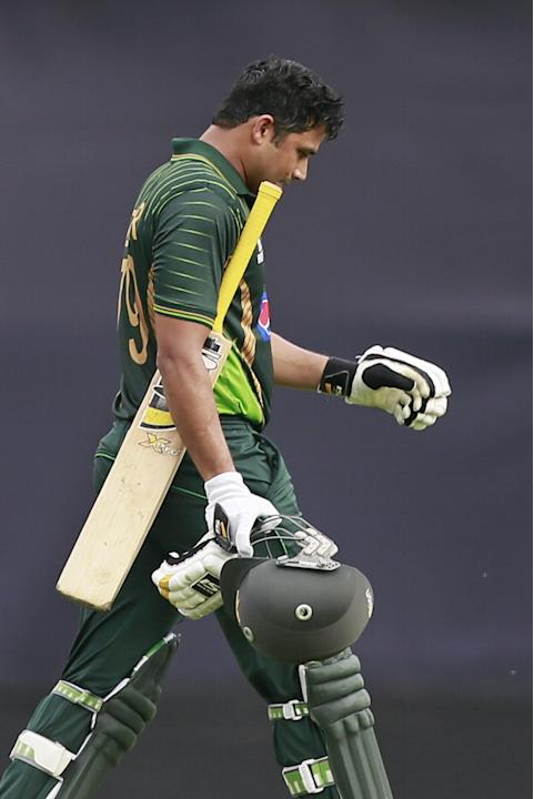 Pakistan's captain Azhar Ali walks back to the pavilion after his dismissal during the second one-day international cricket match against Bangladesh in Dhaka, Bangladesh, Sunday, April 19, 2015. (AP P