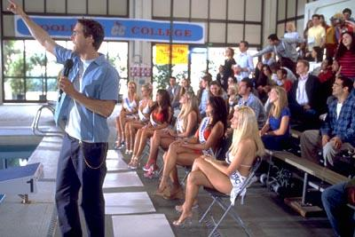 Van Wilder ( Ryan Reynolds ) rallies the crowd to save the Coolidge College swim team in Artisan's National Lampoon's Van Wilder