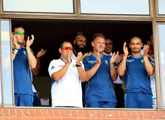 South African cricket team celebrates century of Jacques Kallis during the 4th Day of the Second Test match between India and South Africa played at Kingsmead Stadium in Durban on Dec.29, 2013. (Photo