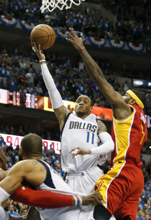 FILE - In this April 24, 2015, file photo, Dallas Mavericks' Monta Ellis (11) goes up to shoot against Houston Rockets' Josh Smith, right, in the second half of Game 3 in an NBA basketball fir