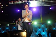 Singer Harry Styles and the group One Direction perform at Z100's Jingle Ball 2012 presented by Aeropostale at Madison Square Garden on Friday Dec. 7, 2012 in New York. (Photo by Evan Agostini/Invision/AP)