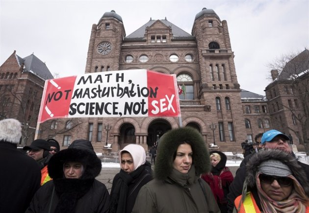 Demonstrators gather in front of Queen's Park to protest against Ontario's new sex education curriculum in Toronto on Tuesday, February 24, 2015. THE CANADIAN PRESS/Darren Calabrese