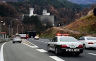 Police vehicles block the road leading to the entrance of the collapsed Sasago tunnel on the Chuo Expressway, 80 kilometres west of the capital. Japanese rescuers found five charred bodies and a trucker was pronounced dead after being pulled from his vehicle following the collapse