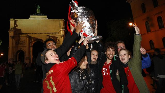 Champions League - Munich parties as Dortmund mourns in divided Germany