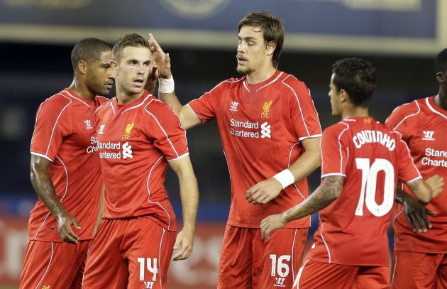 Liverpool's Jordan Henderson (14) celebrates with teammates after scoring a goal in the second half of a Guinness International Champions Cup soccer tournament match Wednesday, July 30, 2014, in New York. Liverpool won the game 3-2 in a penalty kick shootout. (AP Photo/Frank Franklin II)