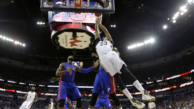 New Orleans Pelicans forward Anthony Davis (23) goes to the basket in front of Detroit Pistons center Andre Drummond (0) and another defender during the first half of an NBA basketball game Wednesday, March 4, 2015, in New Orleans. (AP Photo/Gerald Herbert)