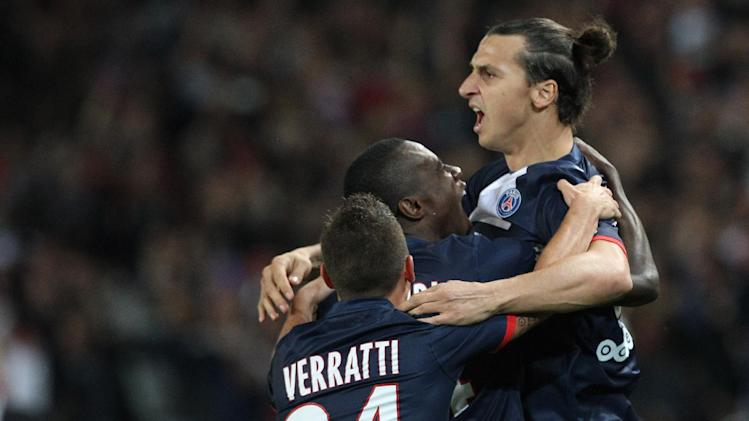 Paris Saint Germain's forward Zlatan Ibrahimovic from Sweden, right, celebrates with his teammates Blaise Matudi, center, and Marco Verratti from Italy,  after scoring a goal, during his French League One soccer match against Monaco, at the Parc des Princes stadium, in Paris, Sunday, Sept. 22, 2013