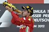 Ferrari's Spanish driver Fernando Alonso celebrates on the podium at the Hockenheimring circuit during the German Formula One Grand Prix. Alonso extended his lead in this year's Formula One drivers' world championship on Sunday when he drove to a flawless victory for Ferrari in the German Grand Prix