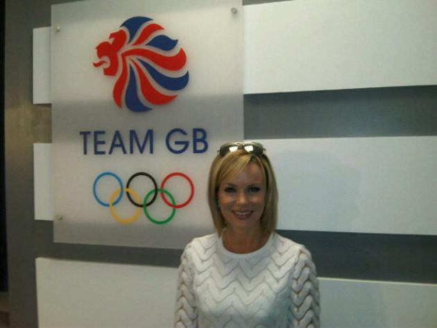 """Celebrity photos: Amanda Holden was also at the Olympics Opening Ceremony. She tweeted this photo of herself next to a sign for Team GB, along with the caption: """"Go @TeamGB. So excited!! At Opening ce"""