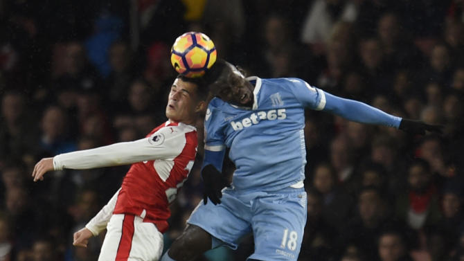 Arsenal's Granit Xhaka in action with Stoke City's Mame Biram Diouf