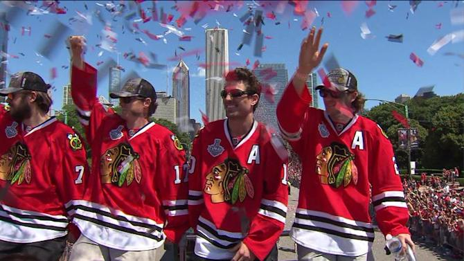 Hawks` Stanley Cup parade rides through downtown streets