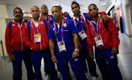 Members of Cuba's Olympic weightlifting team at Heathrow airport on July 16, 2012, ahead of the London 2012 Olympic Games. Most Cubans next week will have the right to travel without government permission for the first time in decades, but sports stars will still require permission to leave, an official said Tuesday
