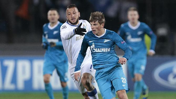 Porto's Nabil Ghilas, left, challenges Zenit's Andrey Arshavin during the Champions League group G soccer match between Zenit and Porto at Petrovsky stadium in St.Petersburg, Russia, on Wednesday, Nov. 6, 2013