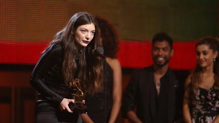 "Lorde accepts the award for best pop solo performance for ""Royals"" at the 56th annual Grammy Awards at Staples Center on Sunday, Jan. 26, 2014, in Los Angeles. (Photo by Matt Sayles/Invision/AP)"